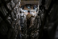Staff Sgt. Dwayne Baldwin, 701st Airlift Squadron loadmaster, inspects cargo before departing to Johan Adolf Pengel International Airport, Suriname from Joint Base Charleston, South Carolina, July 16, 2021.