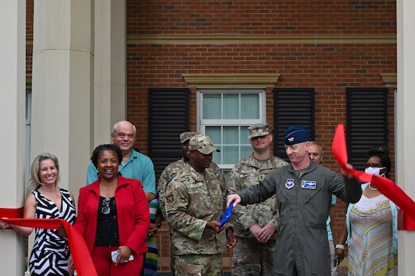 U.S. Air Force Col. Seth Graham (Right), 14th Flying Training Wing commander, and Chief Master Sgt. Antonio Cooper (Left), 14FTW command chief, share a laugh during a briefing tour of the  new Welcome Center, July 20, 2021, on Columbus Air Force Base, Miss. The Welcome Center was inspired by the Air Force True North Program, which seeks to help improve the well-being of Airmen and their families. (U.S. Air Force photo by Airman 1st Class Jessica Haynie)