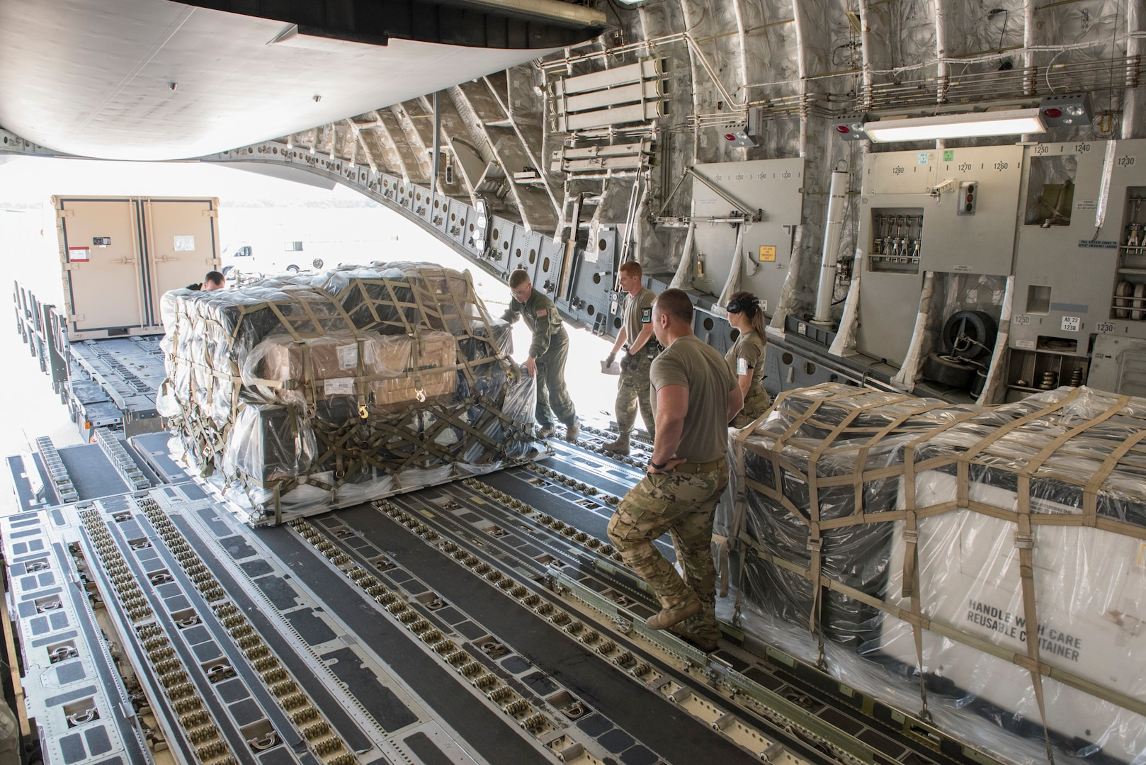 Aerial transportation specialists and loadmasters from the 167th Airlift Wing, West Virginia National Guard, and 123rd Airlift Wing, Kentucky National Guard, load palletized cargo onto a C-17 Globemaster III aircraft during a cargo loading exercise at the 167th Airlift Wing, Martinsburg, West Virginia, July 14, 2021. The 167th hosted members from the 123rd for a small air terminal training in preparation for their upcoming deployment.