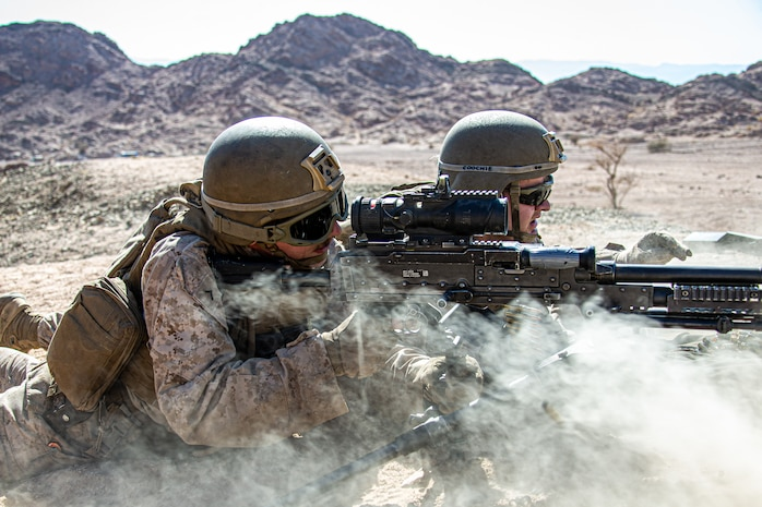 U.S. Marines with 2nd battalion, 1st Marines, assigned to Special Purpose Marine Air-Ground Task Force – Crisis Response – Central Command (SPMAGTF-CR-CC) fire a M240B medium machine gun while training in Jordan, June 23, 2021. SPMAGTF-CR-CC is designed to respond rapidly and efficiently to a wide-range of military operations utilizing aviation, ground, and logistics assets. (U.S. Marine Corps photo by Cpl. Jacob Yost).