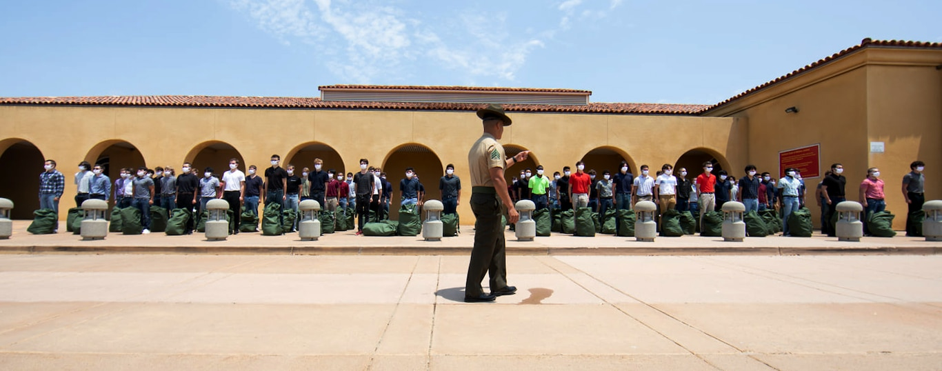 New recruits with Alpha Company, 1st Recruit Training Battalion, participate in receiving at Marine Corps Recruit Depot, San Diego, July 13, 2021.