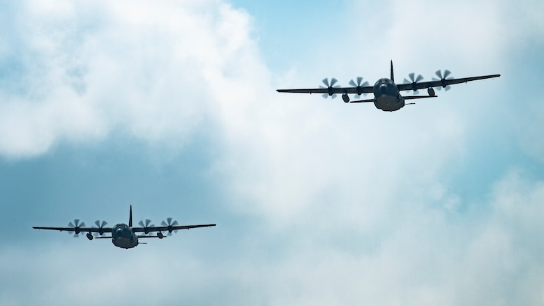 Two U.S. Air Force AC-130J Ghostriders, one assigned to the 4th Special Operations Squadron out of Hurlburt Field, Fla., and the other assigned to the 27th Special Operations Group Detachment 2, fly in formation July 19, 2021, at Cannon Air Force Base, N.M. The arrival of Cannon's first AC-130J Ghostrider represents a significant expansion of force generation capacity as AFSOC structures for the reemergence of great power competition, tightening fiscal constraints, and the accelerating rate of technological change, demanding significant transformation to ensure Air Commandos are ready to successfully operate in this new environment. (U.S. Air Force photo by Staff Sgt. Peter Reft) (This photo has been altered for security purposes by blurring out aircraft squadron badges.)