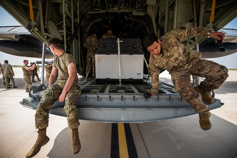27th Special Operations Wing personnel take a tour of the wing's new AC-130J Ghostrider gunship at Cannon Air Force Base, NM, July 19, 2021. The arrival of Cannon's AC-130J represents a significant expansion of AC-130 capacity as AFSOC structures for the future of Special Operations force generation models as Air Commandos adapt to near-peer power competition throughout global operations. (U.S. Air Force photo by Staff Sergeant Candin Muniz) (This photo has been altered for security purposes by blurring out squadron identifiers and nametapes)