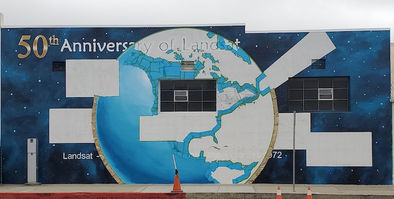 Ann Thompson, City of Lompoc Mural Society curator, started painting the earth of the mural on Ocean Avenue and I street June 27, 2021 in Lompoc, California. The mural will be implementing the history of the progression of the Landsat satellites numbers one through eight. (U.S. Space Force photo by Airman First Class Tiarra Sibley)