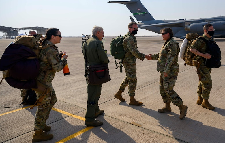 """Airmen from the District of Columbia Air National Guard's 113th Wing, known as the """"Capital Guardians,"""" are welcomed by Lt. Col. Megan Murtishaw, 378th Air Expeditionary Operations Group deputy commander, at Prince Sultan Air Base, Kingdom of Saudi Arabia, July 11, 2021. The wing deployed a contingent of U.S. Air Force F-16 Fighting Falcons to PSAB to reinforce the base's defensive capabilities, provide operational depth, and support U.S. Central Command operations in the region. (U.S. Air Force Photo by Senior Airman Samuel Earick)"""