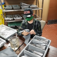 Jason Contreras, Project SEARCH intern, prepares cutlery at Club Five Six, Nov. 19, 2020, at Luke Air Force Base, Arizona. Project SEARCH offers high school graduates with significant disabilities, ranging from ages 18-26, internship opportunities centered on professional development, personal growth and technical skill enhancement to increase their probability of securing meaningful and competitive employment following completion of the program. Luke AFB has partnered with Project SEARCH for the past three years allowing interns to work side-by-side with U.S. Air Force personnel to build upon their skill sets, which aids the 56th Fighter Wing's efforts of bolstering partnerships with the local community. (Courtesy photo)