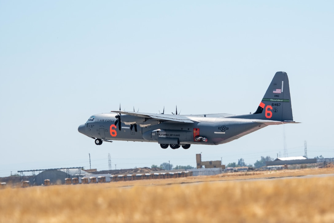 Air National Guard C-130, MAFFS 6 out of Channel Islands, Calif. launches July 14, 2021, from CAL FIRE Air Tanker Base