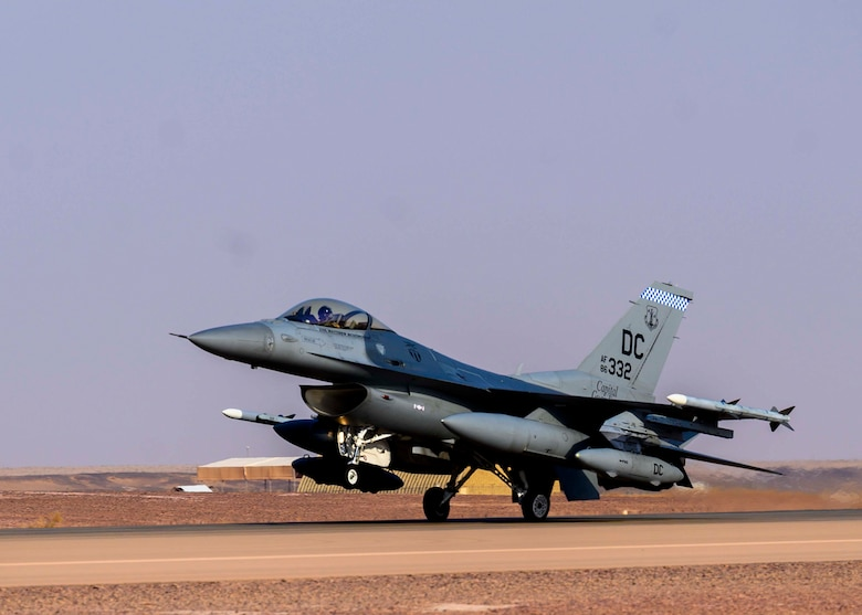 """A U.S. Air Force F-16C Fighting Falcon from District of Columbia Air National Guard's 113th Wing, known as the """"Capital Guardians,""""  lands on the flight line at Prince Sultan Air Base, Kingdom of Saudi Arabia, July 9, 2021. The wing deployed a contingent of F-16s to PSAB to reinforce the base's defensive capabilities, provide operational depth, and support U.S. Central Command operations in the region. (U.S. Air Force Photo by Senior Airman Samuel Earick)"""