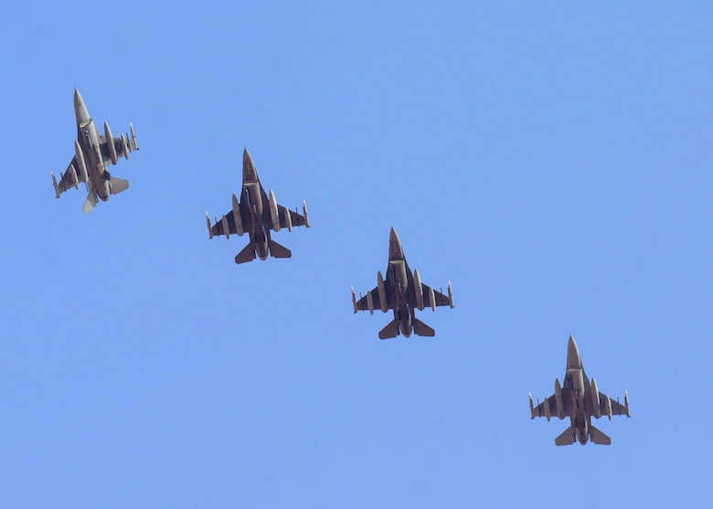 """A U.S. Air Force F-16C Fighting Falcon from District of Columbia Air National Guard's 113th Wing, known as the """"Capital Guardians,"""" banks away from formation in preparation for landing at Prince Sultan Air Base, Kingdom of Saudi Arabia, July 9, 2021. The wing deployed a contingent of F-16s to PSAB to reinforce the base's defensive capabilities, provide operational depth, and support U.S. Central Command operations in the region. (U.S. Air Force Photo by Senior Airman Samuel Earick)"""