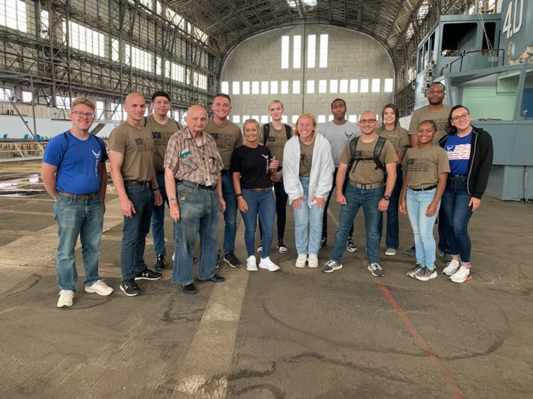 Trainees with the 514th Air Mobility Wing's Developmental Training Flight pose for a photo in Hangar One at Navy Lakehurst. The group toured the legendary Hangar One with Mr. Carl Jablonski, affectionately called Mr. Lakehurst, and Mr. Don Adams from the Navy Lakehurst Historical Society.