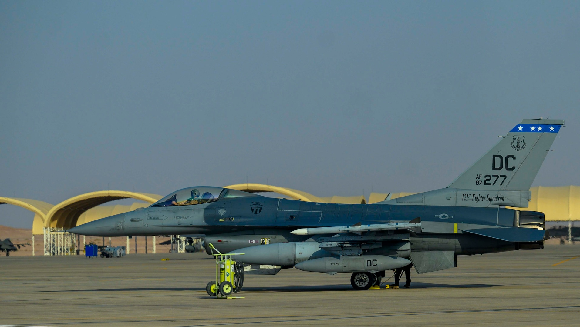 """A U.S. Air Force F-16C Fighting Falcon from District of Columbia Air National Guard's 113th Wing, known as the """"Capital Guardians,"""" sits on the flight line at Prince Sultan Air Base, Kingdom of Saudi Arabia, July 9, 2021. The wing deployed a contingent of F-16s to PSAB to reinforce the base's defensive capabilities, provide operational depth, and support U.S. Central Command operations in the region. (U.S. Air Force Photo by Senior Airman Samuel Earick)"""