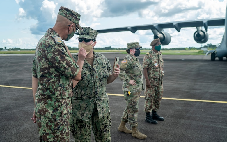 U.S. military and Surinamese military personnel oversee the donation of field hospital equipment at Johan Adolf Pengel International Airport, Suriname, July 16, 2021.