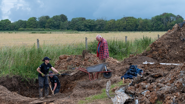 Volunteers with the American Veterans Archeological Recovery group search for remains of fallen service members during a B-24 Liberator excavation at Park Farm in Arundel, England, July 8, 2021. The team was comprised of around 20 volunteers from local universities, veterans from both United States and British armed forces, and active duty service members from RAF Lakenheath. (U.S. Air Force photo by Senior Airman Koby I. Saunders)