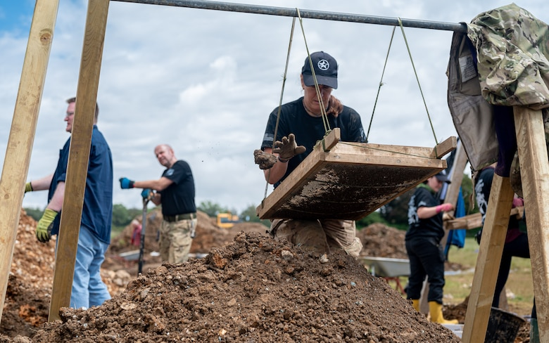Volunteers with the American Veterans Archeological Recovery group search for remains of fallen service members during a B-24 Liberator excavation at Park Farm in Arundel, England, July 8, 2021. AVAR is conducting the dig in conjunction with the Defense POW/MIA Accounting Agency in an effort to recover those still missing in action. (U.S. Air Force photo by Senior Airman Koby I. Saunders)