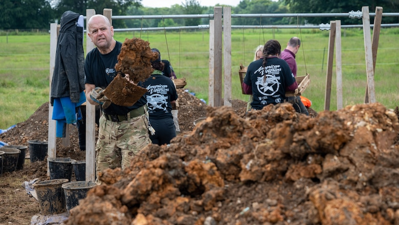 Julian Pitt, a British Navy veteran and volunteer with the American Veterans Archeological Recovery group, searches for remains of fallen service members during a B-24 Liberator excavation at Park Farm in Arundel, England, July 8, 2021. Seven Airmen from RAF Lakenheath had the opportunity to assist in the excavation and work with the AVAR team to recover the remains of these service members. (U.S. Air Force photo by Senior Airman Koby I. Saunders)