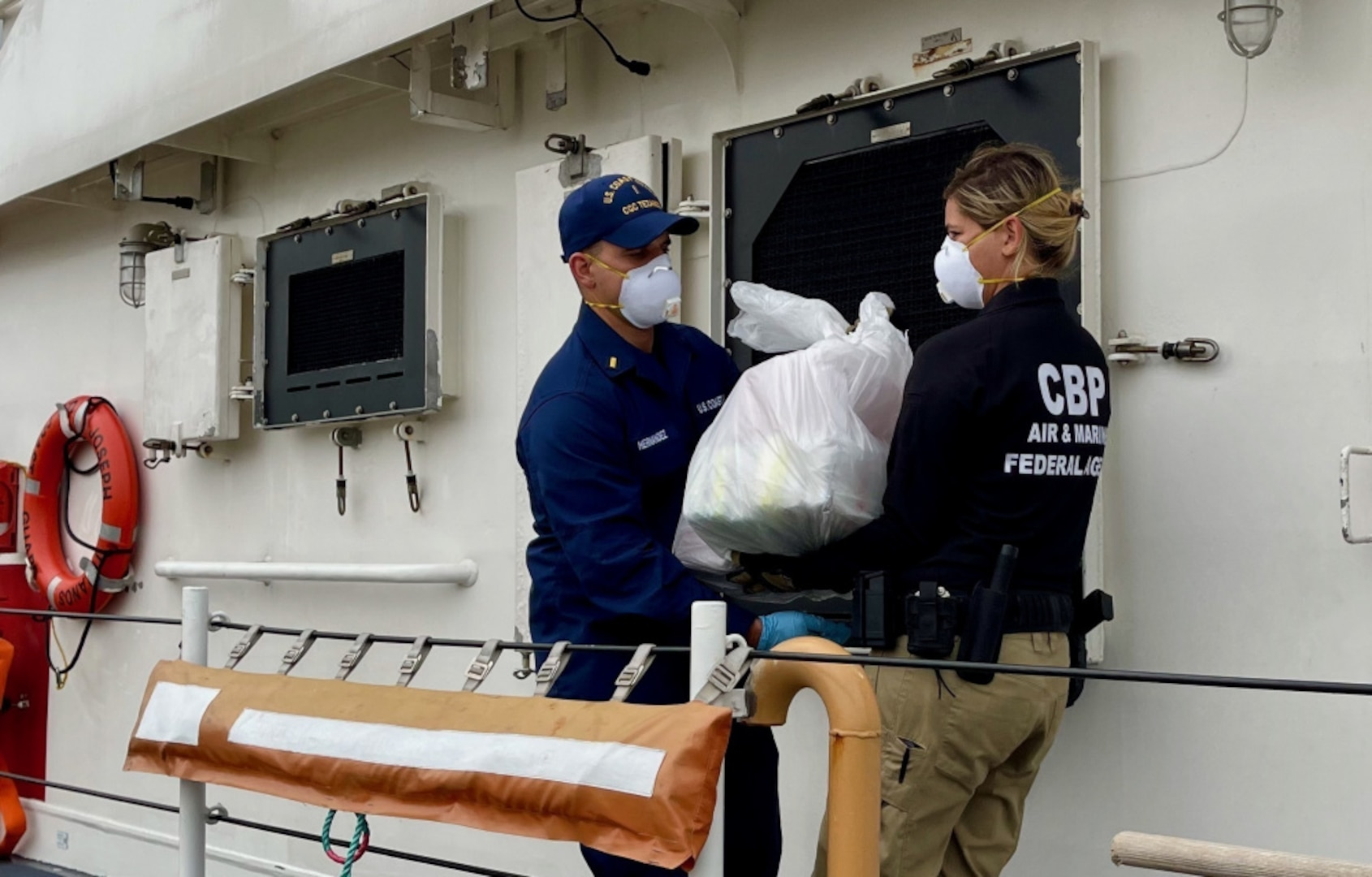 The crew of the Coast Guard Joseph Tezanos offloads nearly $15 million in cocaine and transfers custody of two suspected smugglers at Coast Guard Base San Juan July 12, 2021. Cutter Joseph Tezanos, with the assistance of a Customs and Border Protection (CBP) Air and Marine Operations (AMO) Multi-Role Enforcement Aircraft (MEA) aircraft, interdicted a go-fast vessel in Mona Passage waters July 10, 2021, which resulted in the apprehension of the smugglers and seizure of 502 kilograms of cocaine.  The interdiction resulted from multi-agency efforts in support of U.S. Southern Command's enhanced counter-narcotics operations in the Western Hemisphere and coordination with the Caribbean Corridor Strike Force (CCSF).  (U.S. Coast Guard photo).