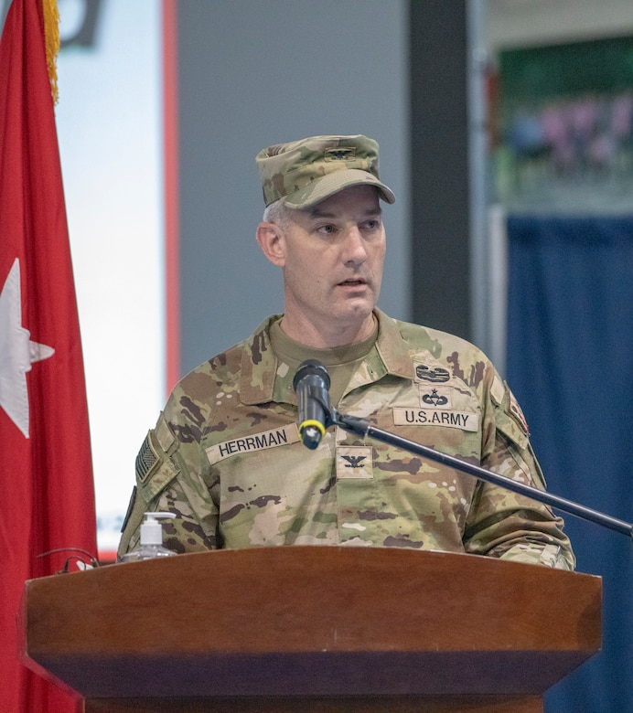 U.S. Army Col. John J. Herrman, outgoing commander of Area Support Group - Kuwait, delivers remarks during ASG-KU's change of command ceremony at Camp Arifjan, Kuwait, July 12, 2021. Herrman expressed gratitude to his team for their support and to the many new friendships he developed during his tenure. (U.S. Army photo by Staff Sgt. True Thao)