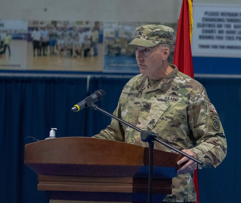 U.S. Army Col. Charles S. Lockwood, incoming commander of Area Support Group - Kuwait, delivers remarks during a change of command ceremony at Camp Arifjan, Kuwait, July 12, 2021. Lockwood said that he is excited to work along his new team and Kuwaiti counterparts and hopes to continue to strengthen the partnership between the two nations. (U.S. Army photo by Staff Sgt. True Thao)