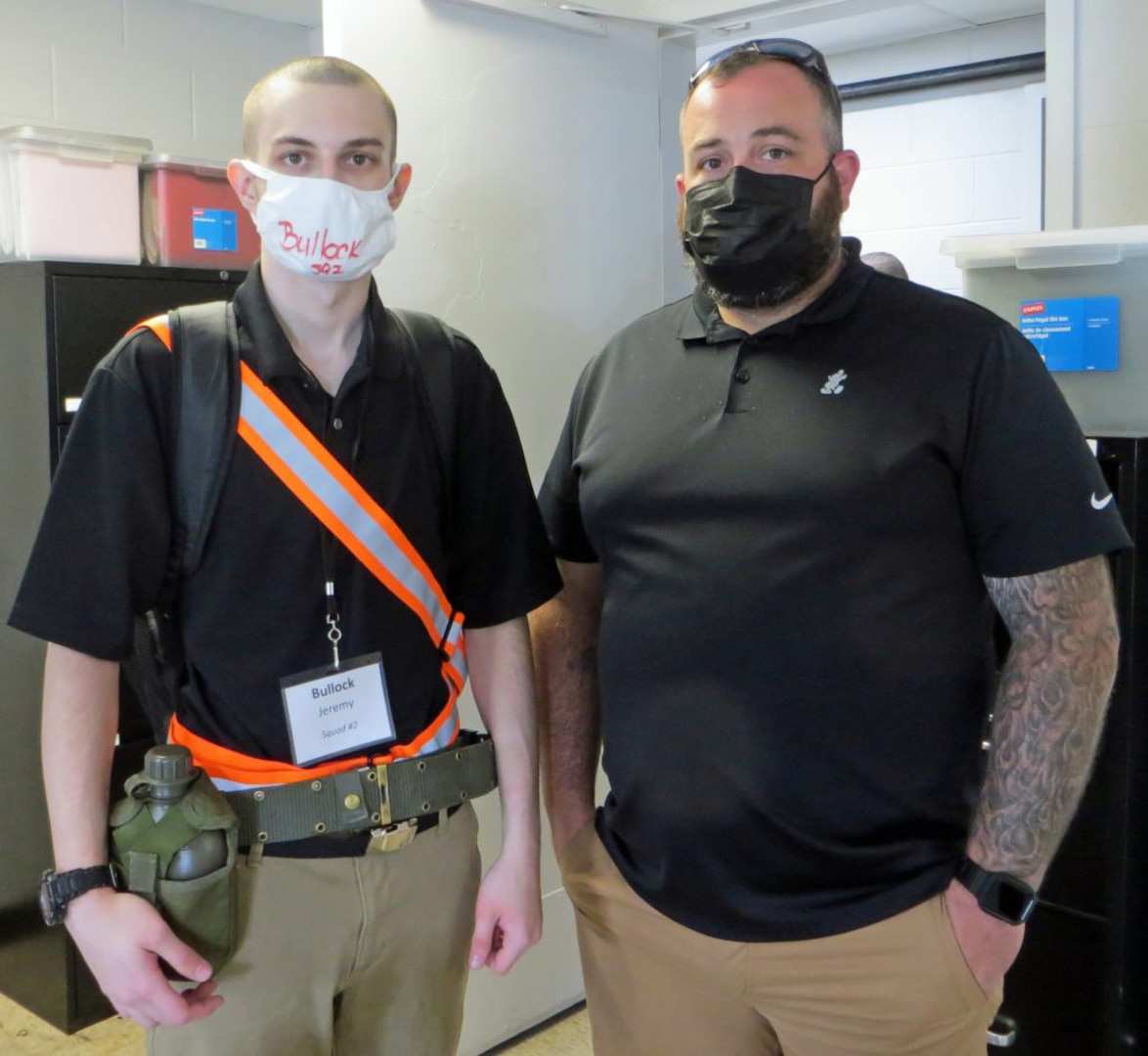 Jeremy Bullock, left, and his father, Brandon, on July 11, 2021, at the Maryland National Guard's Freestate ChalleNGe Academy program at the Edgewood Arsenal of Aberdeen Proving Ground. Jeremy is attending the 18-month program for at-risk youth 20 years after his father graduated from the same program.