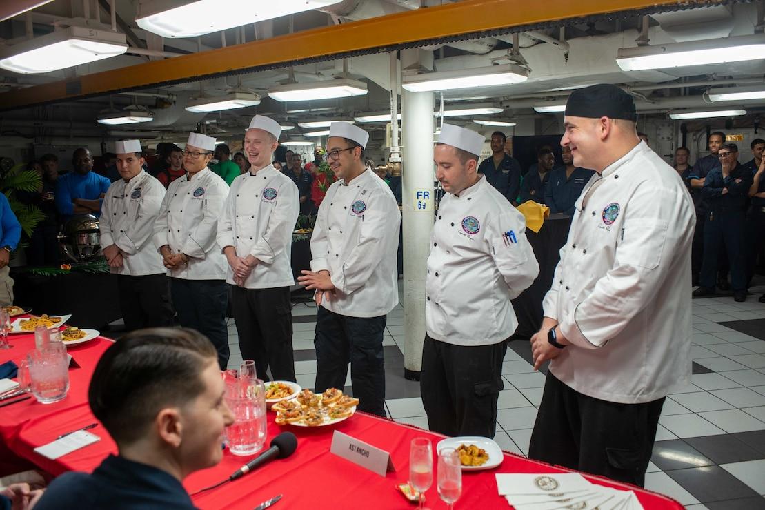 Sailors hold a cook-off event on the forward mess decks of the aircraft carrier USS Ronald Reagan (CVN 76).