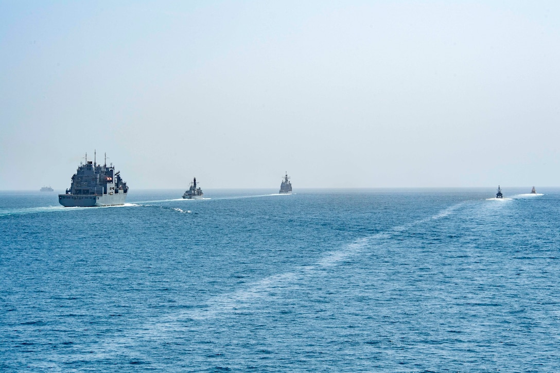 STRAIT OF HORMUZ (July 18, 2021) – Military Sealift Command dry cargo and ammunition ship USNS Cesar Chavez (T-AKE 14), patrol coastal ship USS Whirlwind (PC 11), Royal Navy frigate HMS Montrose (F 236), guided-missile cruiser USS Monterey (CG 61), fast response cutter USCGC Charles Moulthrope (WPC 1141) and guided-missile cruiser USS Shiloh (CG 67), not pictured, transit the Strait of Hormuz, July 18. Shiloh, Cesar Chavez, Whirlwind, Montrose, Monterey and Charles Moulthrope are deployed to the U.S. 5th Fleet area of operations in support of naval operations to ensure maritime stability and security in the Central Region, connecting the Mediterranean and Pacific through the western Indian Ocean and three strategic choke points. (U.S. Navy photo by Mass Communication Specialist 1st Class Rawad Madanat)