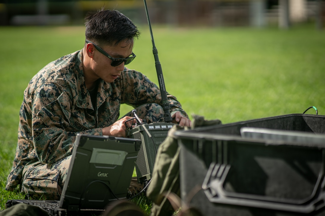 U.S. Marine Corps Cpl. Dustin Nguyen, a Richmond, Va., native and a transmissions systems operator with 1st Battalion, 2nd Marine Regiment, 2nd Marine Division, sets up an AN/PRC-160(V) radio as part of the 2nd MARDIV High-Frequency Competition on Naval Submarine Base Kings Bay, Ga., July 12, 2021. The competition enhanced HF transmission proficiency and capabilities to prepare Marines for future expeditionary conflicts where the area is either contested or degraded.