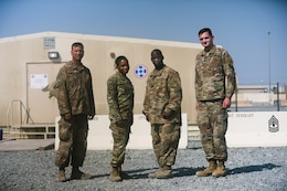 CAMP ARIFJAN, Kuwait-- Master Sgt. Lloyd Cossey, Staff Sgt. Steve Augusten, Sgt. Nichole Hall and Spc. Patrick H. Watrous with the Army Reserve's Indianapolis-based 310th Sustainment Command (Expeditionary) returned here recently after providing support to Soldiers at Afghanistan's Bagram Air Base.