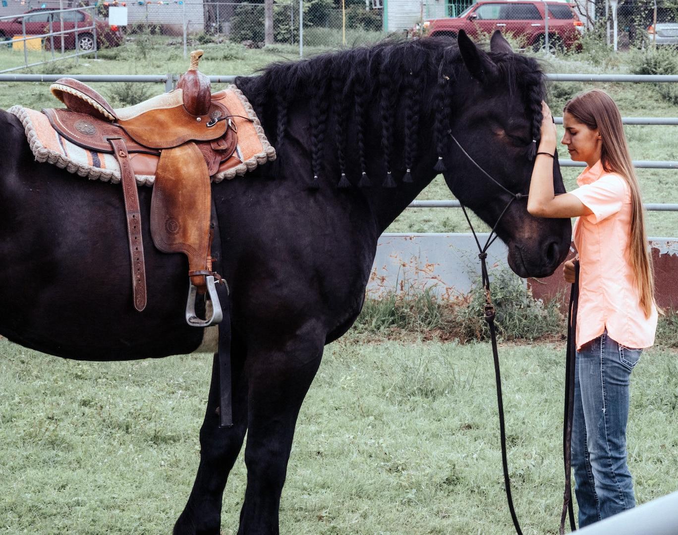 Caroline Stryjewski, an equine trainer for the U.S. Army North Caisson Platoon