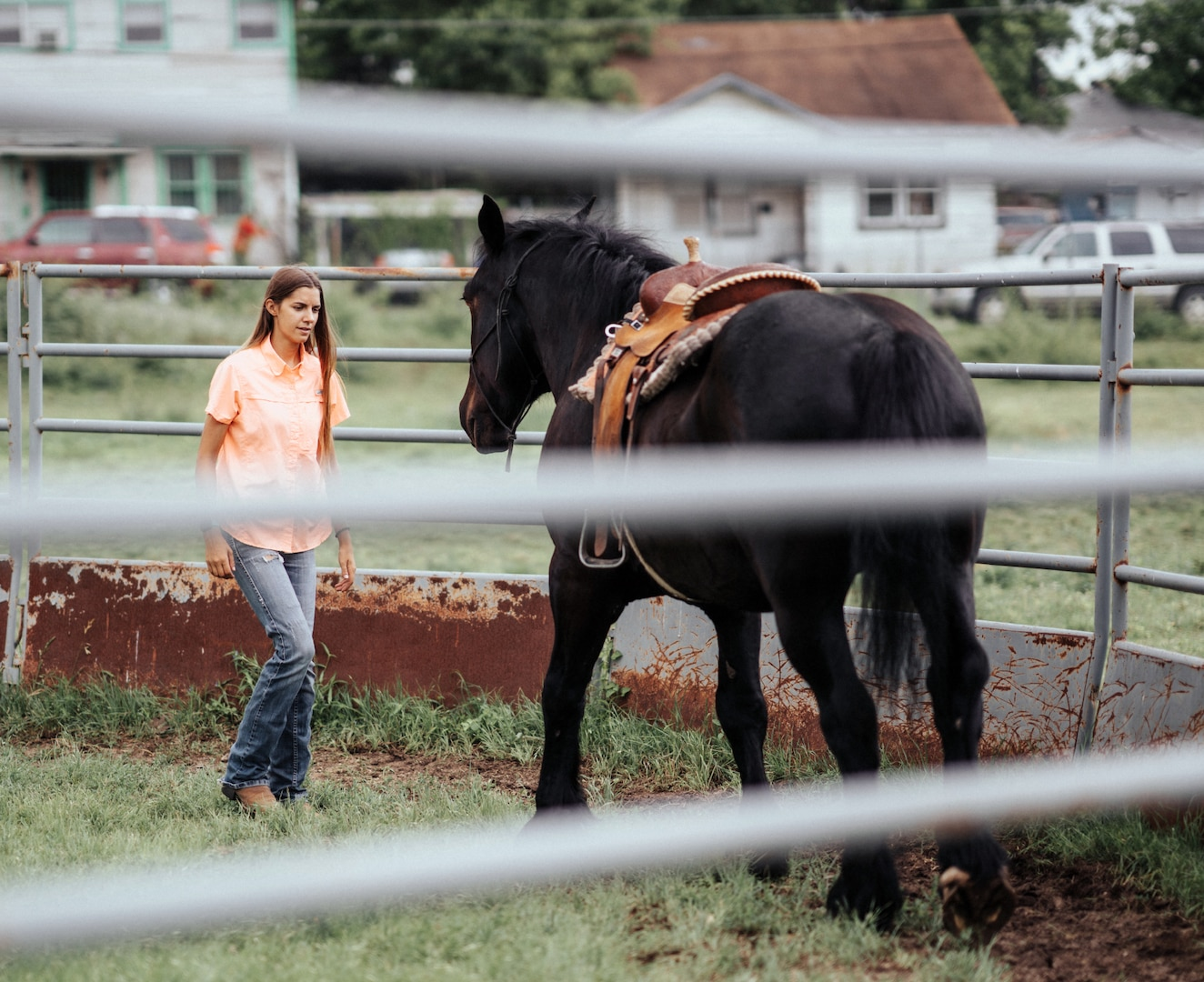 Caroline Stryjewski, an equine trainer for the U.S. Army North Caisson Platoon, conducts groundwork exercises.