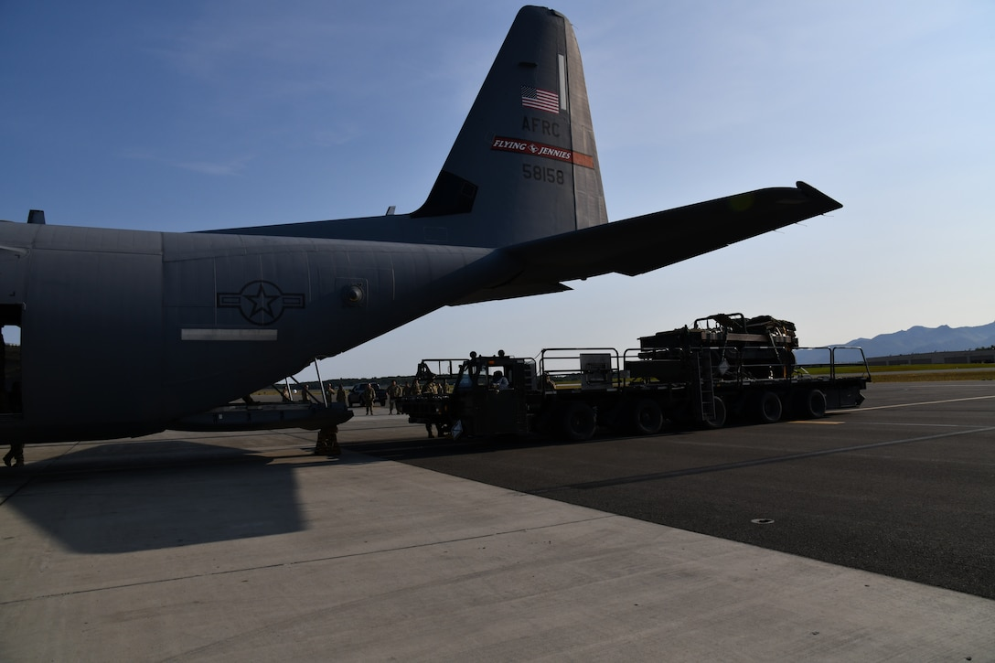 A parachute rigged and palletized Humvee was loaded onto one of the 815th Airlift Squadron's C-130J Super Hercules aircraft for the heavy equipment cargo drop training missions during a training exercise at Joint Base Elmendorf-Richardson, Alaska, July 15, 2021. The 815th AS crews completed three Humvee heavy cargo airdrops totaling over 30,000 pounds of equipment during one formation flight. (U.S. Air Force photo by Master Sgt. Jessica Kendziorek)