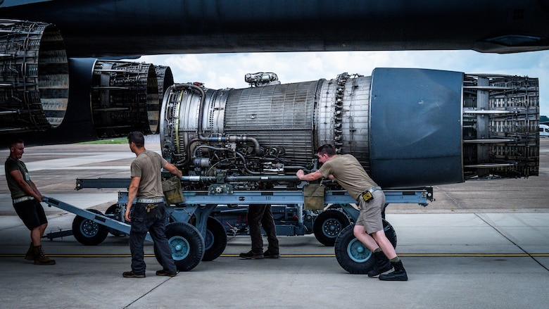 Airmen from Dyess Air Force Base, Texas, remove a F-101 engine from a B-1B Lancer at Barksdale Air Force Base, Louisiana, July 7, 2021.