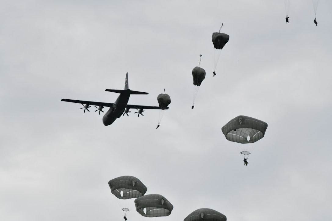 The 815th Airlift Squadron, or Flying Jennies, provided airdrop support for more than 1300 paratroopers from the 4th Infantry Brigade Combat Team Airborne, 25th Infantry Division for their jumps during a training exercise at Joint Base Elmendorf-Richardson, Alaska, July 13-16, 2021. They also dropped over 30,000 pounds of heavy equipment, completed more than eight hours of low-level tactical flight and more than 15 assault landings during the four-day training exercise. (U.S. Air Force photo by Master Sgt. Jessica Kendziorek)
