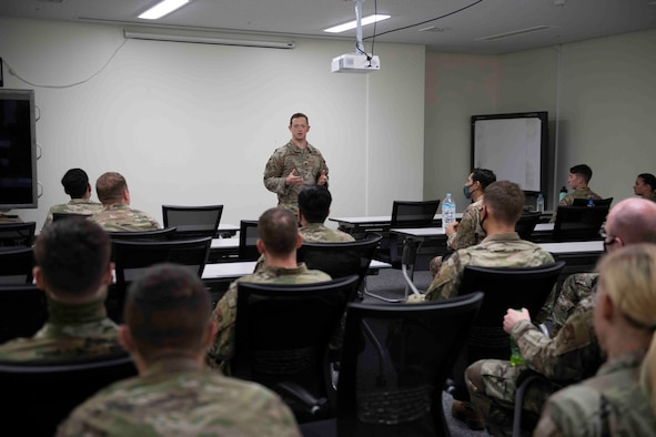 Maj. Matthew Stillman, 374th Security Forces Squadron commander, briefs volunteer Airmen before the start of a 374th Mission Support Group training day at Yokota Air Base, Japan, July 21, 2021.
