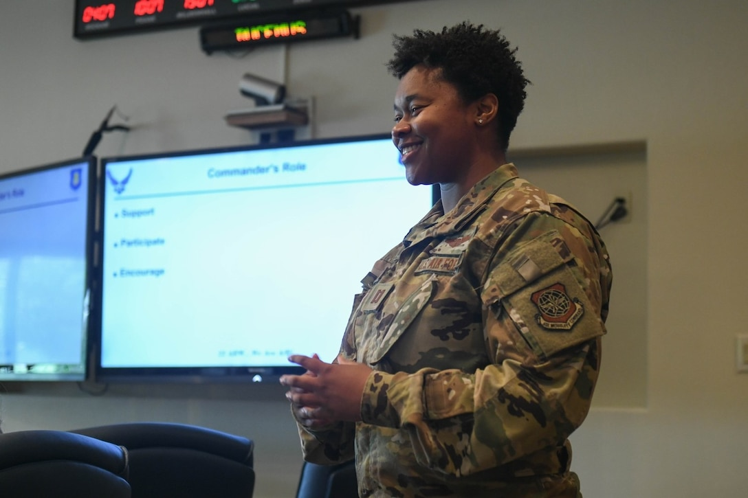 Capt. Cydnee Reese, 22nd Operations Group special operations air refueling mission planner, briefs the wing commander and wing command chief on the program overview of McConnell's Diversity and Inclusion Taskforce July 20, 2021, at McConnell Air Force Base, Kansas. Reese is one of five wing representatives that works to provide events and training to Airmen on diversity and inclusion. Members are certified by the University of Cornell as representatives and are equipped with certified unconscious bias training facilitators. (U.S. Air Force photo by Senior Airman Nilsa Garcia)