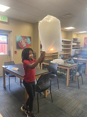 girls playing with lanterns