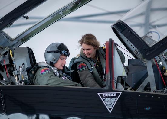 A pilot shows a crew chief controls inside a T-38 Talon