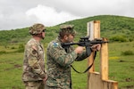 U.S. Army Staff Sgt. Justin Sachariason, left, a Soldier assigned to the Florida Army National Guard's 2nd Battalion, 124th Infantry Regiment, 53rd Infantry Brigade Combat Team, instructs 1st Lt. Almir Sarac, a soldier with the Armed Forces of Bosnia and Herzegovina, how to shoot the M4A1 carbine rifle at Manjaca Training Area, Bosnia and Herzegovina, May 19, 2021.