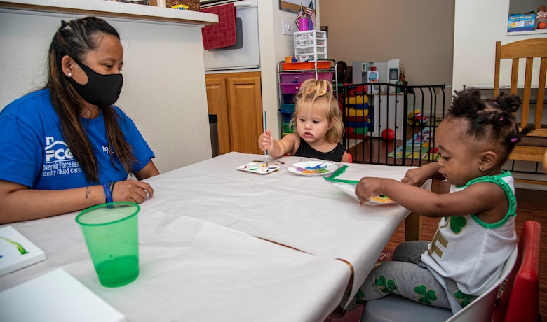 Cherise Vogel, 436th Force Support Squadron Family Child Care provider, watches children paint at her home on Dover Air Force Base, Delaware, July 20, 2021. The FCC program offers an alternate option to the Child Development Center or Youth Center on base, providing in-home care for infants through school-aged children. (U.S. Air Force photo by Tech. Sgt. Nicole Leidholm)