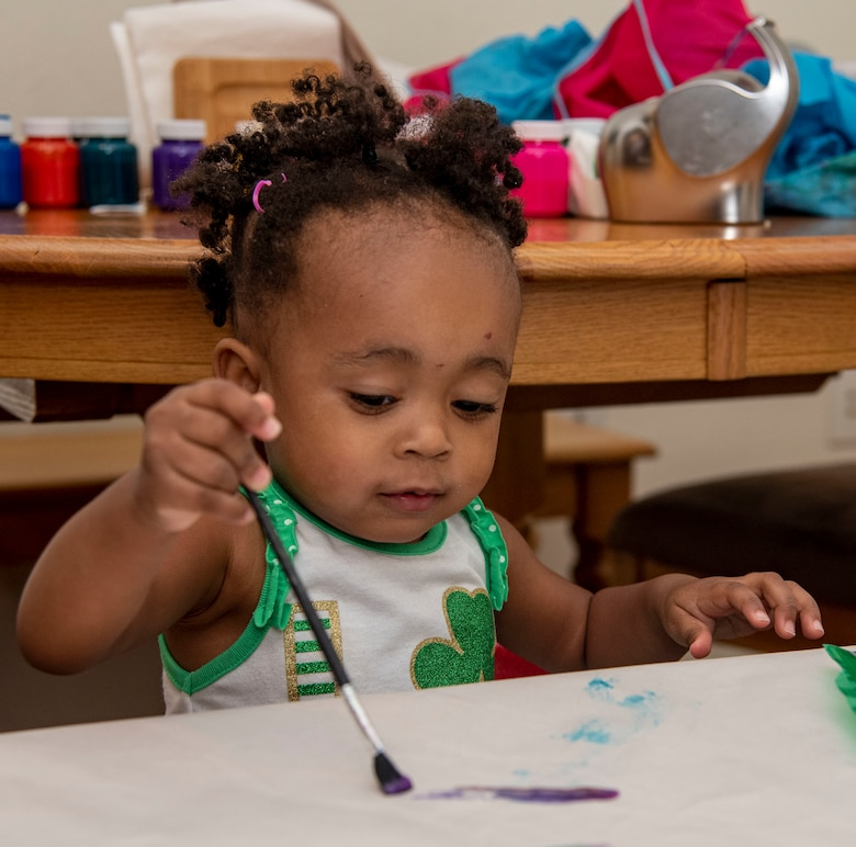 Amani Bailey, daughter of Tech. Sgt. Justin Bailey, 436th Aerial Port Squadron noncommissioned officer in charge of passenger services, paints as part of the Family Child Care program on Dover Air Force Base, Delaware, July 20, 2021. The FCC program offers an alternate option to the Child Development Center or Youth Center on base, providing in-home care for infants through school-aged children. (U.S. Air Force photo by Tech. Sgt. Nicole Leidholm)