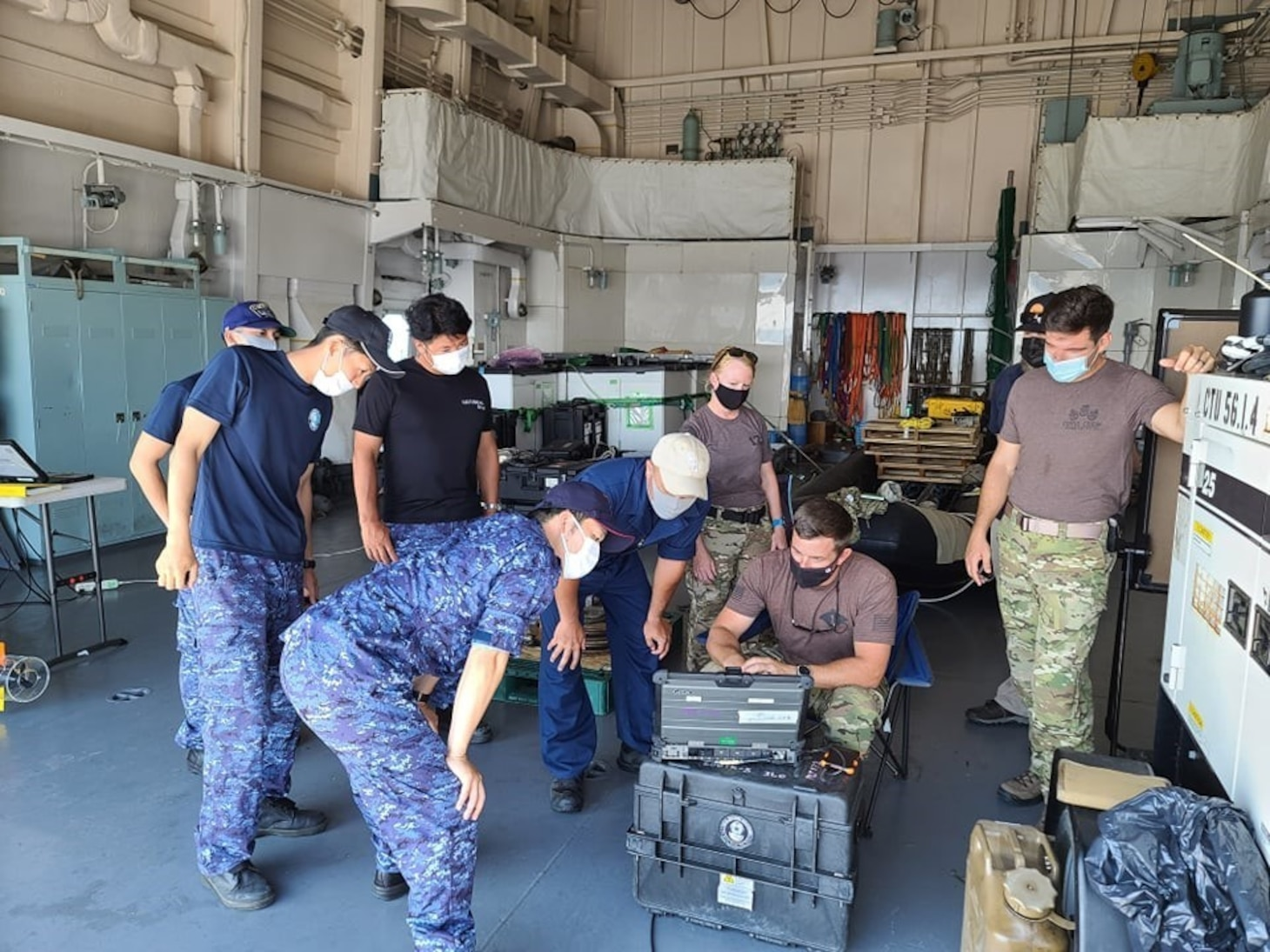 MUTSU BAY (July 19, 2021)- - Members of the Japan Maritime Self-Defense Force (JMSDF) and the U.S. Navy participate in improvised explosive device training  during 2JA Mine Warfare Exercise (MIWEX) in Japan's Mutsu Bay. 2JA MIWEX is an annual bilateral exercise between the U.S. Navy and Japan Maritime Self-Defense Force to strengthen interoperability and increase proficiency in mine countermeasure operations