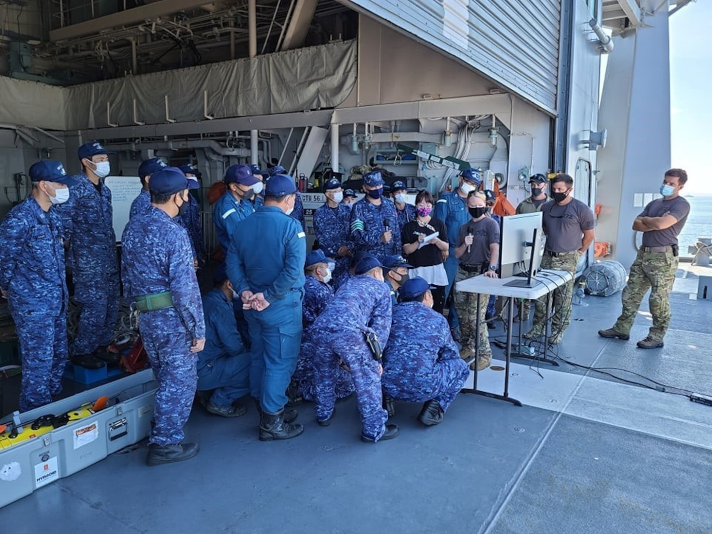 MUTSU BAY(July 19, 2021)- Members of the Japan Maritime Self-Defense Force (JMSDF) and the U.S. Navy participate in improvised explosive device training  during 2JA Mine Warfare Exercise (MIWEX) in Japan's Mutsu Bay. 2JA MIWEX is an annual bilateral exercise between the U.S. Navy and Japan Maritime Self-Defense Force to strengthen interoperability and increase proficiency in mine countermeasure operations