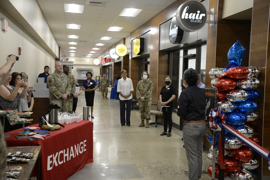 Installation leaders join Army & Air Force Exchange Service managers during the opening of Bunker 27 at Wright-Patterson Air Force Base on July 15. A ribbon-cutting ceremony marked the new store's opening at the Base Exchange.