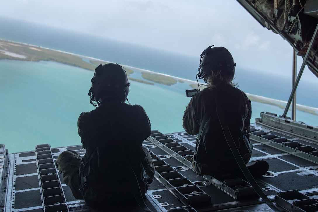 Airmen from the Kentucky Air National Guard's Public Affairs Office capture photos and video during a familiarization flight aboard a 123rd Airlift Wing C-130 Hercules over Puerto Rico on June 14, 2021, as part of Maintenance University. More than 150 Airmen from the Kentucky Air Guard trained on career-specific proficiencies during the intensive week-long course. (U.S. Air National Guard photo by Phil Speck)