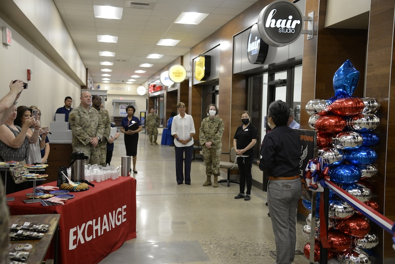 Installation leaders join Army & Air Force Exchange Service managers during the opening of Bunker 27 at Wright-Patterson Air Force Base on July 15. A ribbon-cutting ceremony marked the new store's opening at the Base Exchange. (U.S. Air Force photo by Airman 1st Class Jack Gardner)