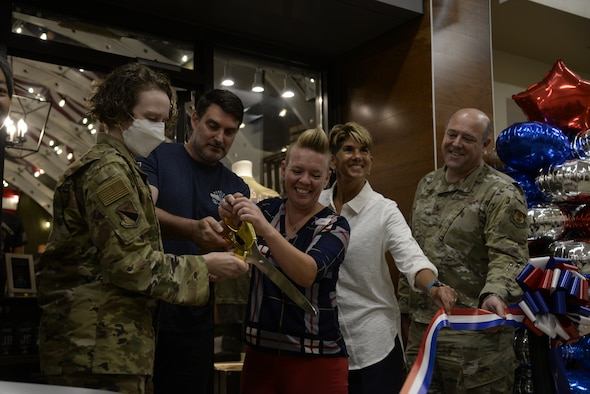 From left: Col. Sirena Morris, 88th Mission Support Group commander; Darren Moore, Bunker 27 founder and owner; Sarah Bateman, Base Exchange services business manager; Elizabeth Goodman-Bluhm, the Army & Air Force Exchange Service's Central Region vice president; and Col. Patrick Miller, 88th Air Base Wing and installation commander, cut the ribbon July 15 on the new Bunker 27 at Wright-Patterson Air Force Base. (U.S Air Force photo by Airman 1st Class Jack Gardner)