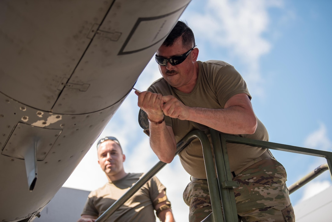 Master Sgt. Chuck Rodgers (right), a propulsion elements supervisor from the Kentucky Air National Guard's 123rd Maintenance Squadron, and Staff Sgt. Mike Hasson, an aerospace maintenance craftsman from the same unit, install engine panels on a C-130 Hercules at Muñiz Air National Guard Base in Carolina, Puerto Rico, on June 13, 2021, as part of Maintenance University. More than 130 Airmen from the Kentucky Air Guard's 123rd Airlift Wing trained on career-specific proficiencies during the intensive week-long course. (U.S. Air National Guard photo by Phil Speck)