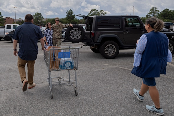 Photo of Defense Commissary Agency employees completing a Click2Go order