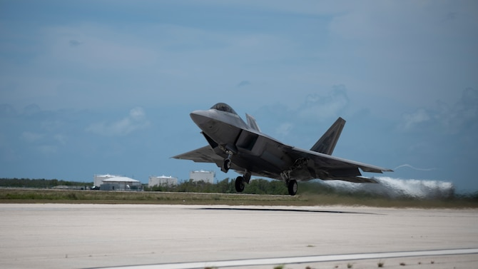 A fighter jet takes off