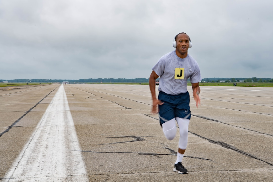 Senior Airman Christopher Simpson, 434th Force Support Squadron personnelist, runs on the flightline at Grissom Air Reserve Base, Indiana, July 11, 2021. Grissom began fitness assessments this month for the first time since the COVID-19 pandemic. (U.S. Air Force photo by Staff Sgt. Jeremy Blocker)