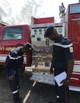 Two members of Senegal's National Fire Brigade examine a Vermont National Guard fire response vehicle July 12, 2021, at Camp Johnson, Vermont National Guard Joint Force Headquarters in Colchester. Delegates from Senegal's fire brigade visited Vermont as part of the National Guard's State Partnership Program.